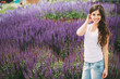 Smiling girl on lavender background.