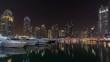 Dubai marina bay with yachts an boats night timelapse hyperlapse