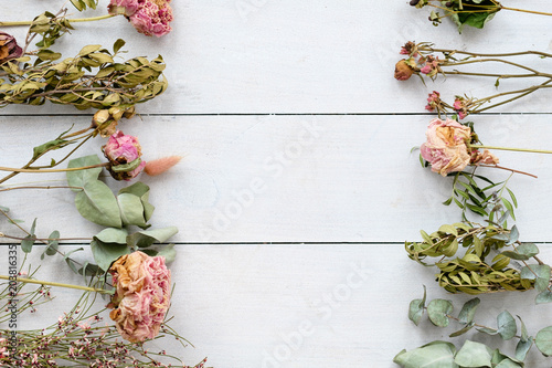 romantic dried flower and twigs composition on white wooden background. copyspace concept