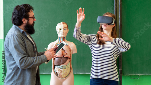 Young teacher using Virtual Reality Glasses and 3D