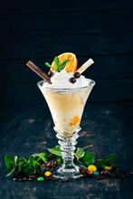 Ice Cream With Oranges. On A B...