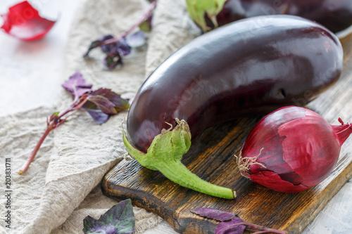 Purple aubergine and red onion closeup.