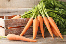 Fresh And Ripe Carrots In Crat...