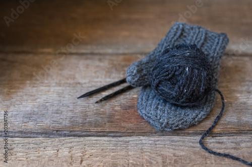 Black wool yarn on the handmade mitt, rustic wabi sabi style
