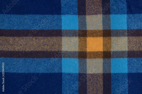 Photo  Orange and blue plaid pattern on blanket texture