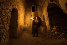 Man With Kerosene Lamp Explores Ancient Abandoned Underground Chalky Cave Temple.