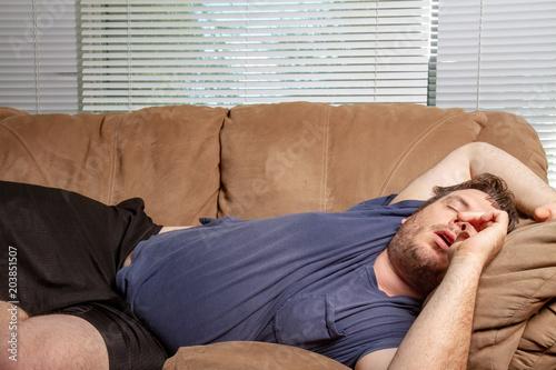 Obraz fat tired man passed out - fototapety do salonu