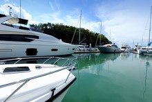 Luxury Yachts Float On Crystal Clear Sea In Marina Bay Club