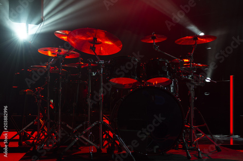 Canvas Prints Flame A kit of drums and a microphones on an empty stage in blue smoke before the concert