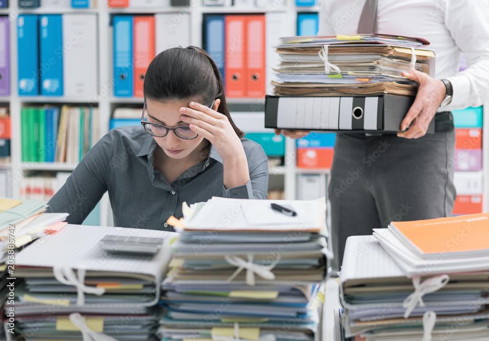 Fototapeta Young secretary overwhelmed by work