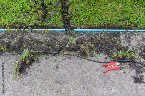 installation of electric wire or cable on ground, blue ... on