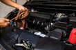 Professional check engine oil details and cleaning before traveling