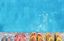 Feet In Flip Flops On Stone Ba...