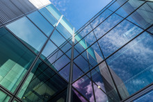 The Glass Architecture In City Against A Sky