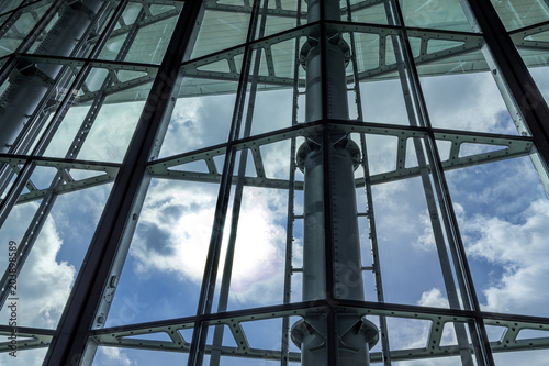 Fényképezés  The glass architecture in city against a sky