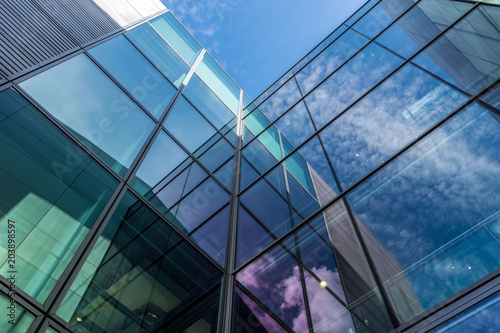 Fotografia, Obraz  The glass architecture in city against a sky