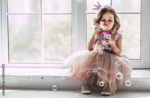Photo Little cute girl in dress