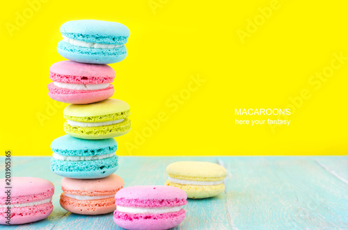 Poster Macarons French macaron cookies on bright yellow background.Sweet dessert.