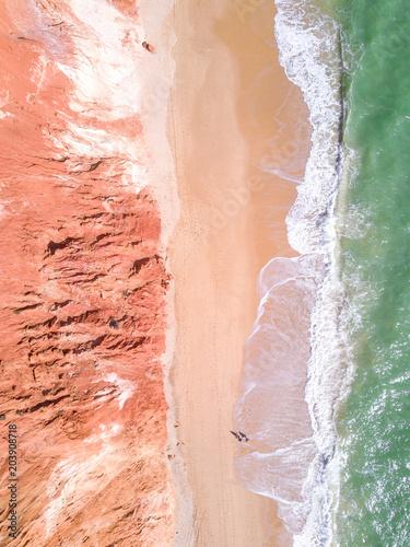 Wall Murals Air photo Overhead shot of beautiful sandy beach and ocean.
