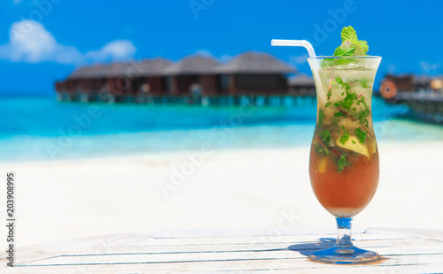 Tuinposter Cocktail cocktail with blur beach on background