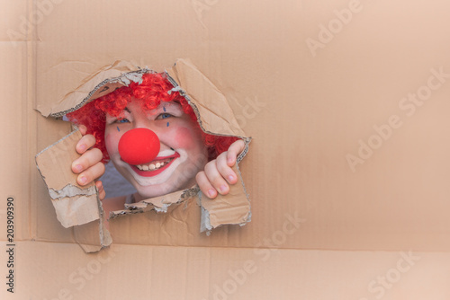 Foto op Aluminium Carnaval Funny kid clown with red nose playing