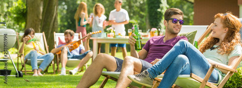 Couple talking during party