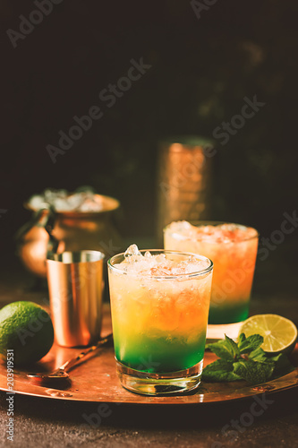 Tuinposter Cocktail Orange cocktail decorated with lime