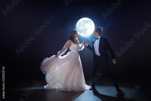 Mysterious and romantic meeting, the bride and groom under the moon Canvas Print