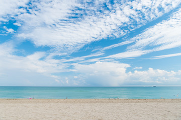 Fototapeta na wymiar Sea beach with white sand and blue water in miami, usa. Seascape on cloudy sky. Summer vacation on tropical resort. Discovery or adventure and wanderlust