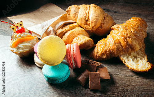 French pastries, desserts: croissants, macaroons, cake, chocolate Canvas Print