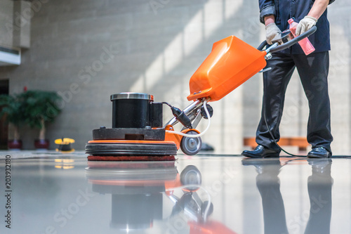 Fotografie, Obraz  cleaning floor with machine