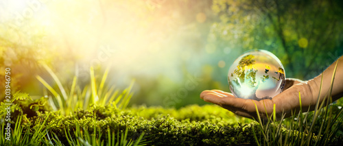Foto op Canvas Natuur Glass globe in hand