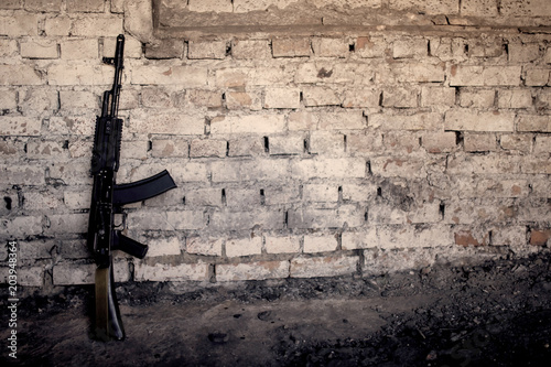 Photo submachine gun kalashnikov AK-47 against the wall