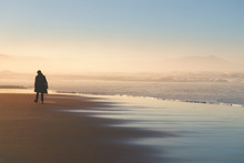 Lonely Person Walking On Beach...
