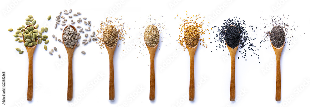 Fototapety, obrazy: Set of spoons with different seeds on white background