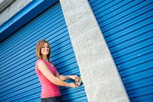 Storage: Woman Putting Lock On...