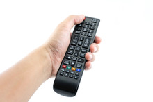 Hand Pressing Power Button On TV Remote Control