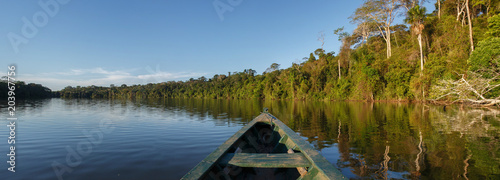 Canoe in the amazon forest, Peru. Canvas Print