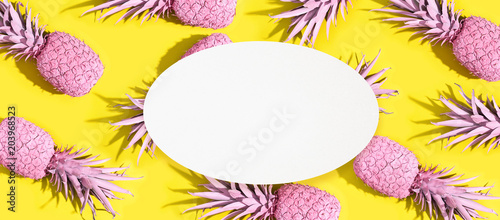 Painted pineapples on a vivid yellow background