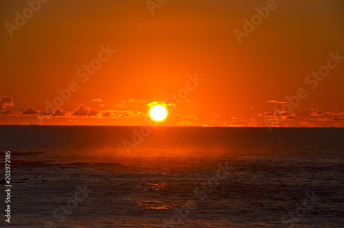 Papiers peints Orange eclat Spectacular sunset in Camps Bay, South Africa