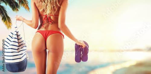 Fotografie, Obraz  Beautiful girl in a tropical beach ready for summer holidays.