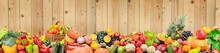 Panoramic Photo Healthy Vegetables And Fruits Against Light Wooden Wall.