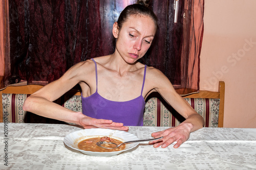 Young skinny anorexic girl with anorexia refusing to eat Wallpaper Mural