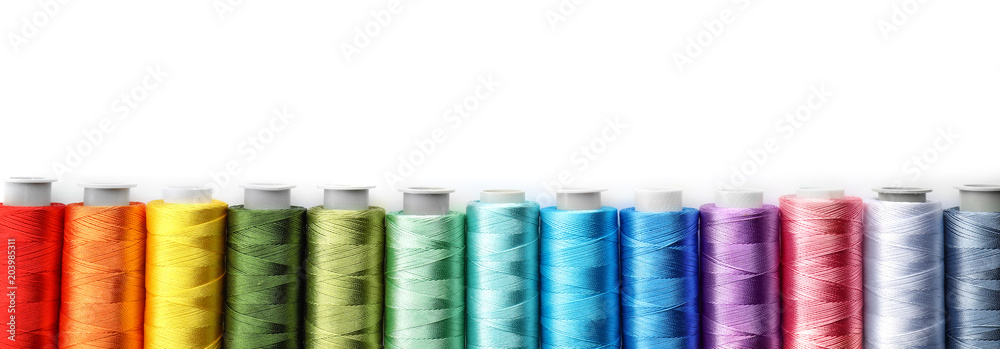 Fototapety, obrazy: Color sewing threads on white background, top view