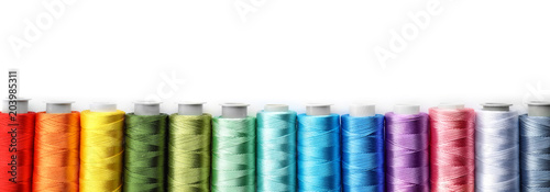 Obraz na plátně Color sewing threads on white background, top view