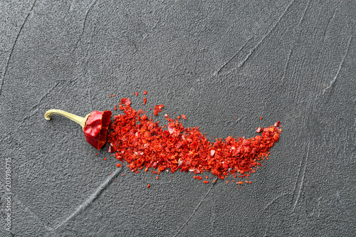 Printed kitchen splashbacks Composition with chili pepper flakes on grey background, top view