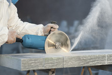 Worker Cuts Stone Grinding Mac...