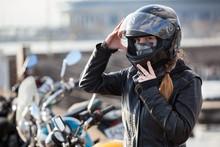 Young Girl Biker Trying Black Motorcycle Helmet For Ride On Bike