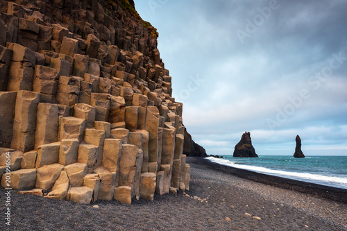 Basalt rock formations Troll toes on black beach. Reynisdrangar, Vik, Iceland