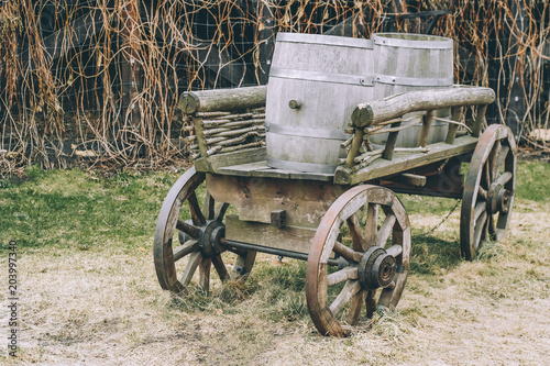 Fototapety, obrazy: Antique cart with three barrels for transporting goods toned